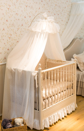 cot: Wooden baby cot with curtain