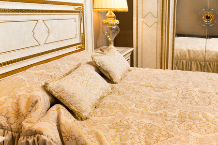 luxury bed: Classical luxury bed with pillows closeup