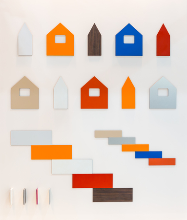 against white: Cardboard patterns of multicolored buildings against white