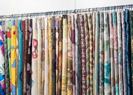 exemplary: Different fabrics hang on the stand