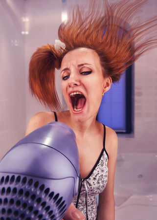 drier: Excited strange woman drying her hair with drier