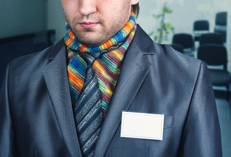 neck scarf: Businessman in modern suit with a colorful scarf on his neck