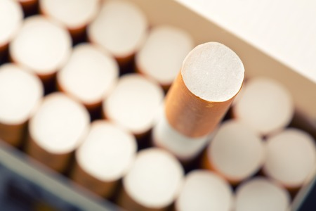 Close up of pack full of cigarettes with one cigarette chosen