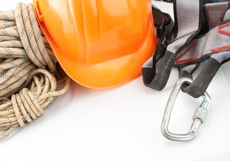 rapell: New climbing equipment of carabiner, orange helmet and rope