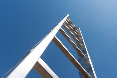 property ladder: High metal ladder leading to the sky