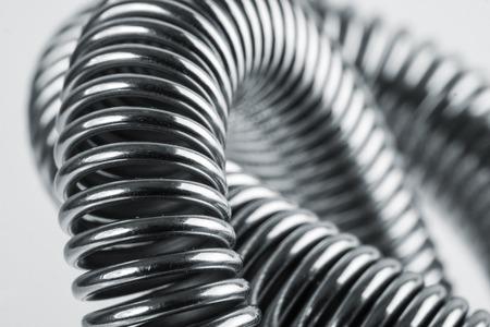 コイル状の金属バネのクローズ アップ 写真素材