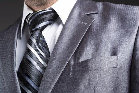 formal clothes: Close up of businessman in modern office suit
