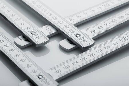 metre: Metal metre measure ruler over white