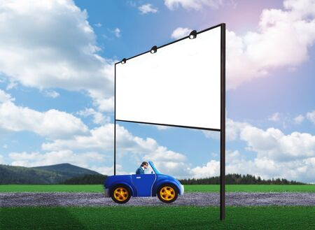 man power: Businessman driving a toy car on a road towards the billboard Stock Photo