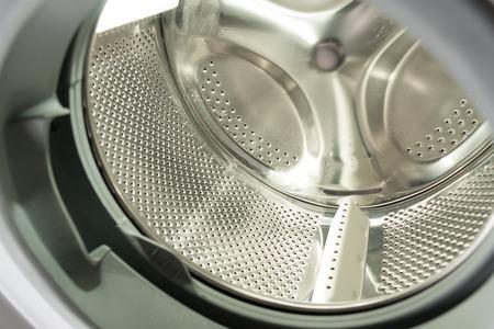 launderette: Empty washing machine drum closeup Stock Photo