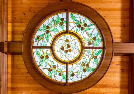 glasswork: Round beautiful stained window with acorn pattern Stock Photo
