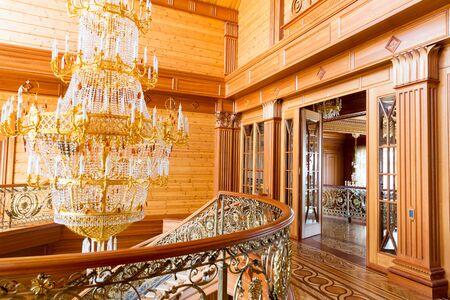 sumptuousness: Novi Petrivtsi, Ukraine - May 27, 2015 Mezhigirya residence of ex-president of Ukraine Yanukovich. Modern gilded chandelier in the hall Editorial