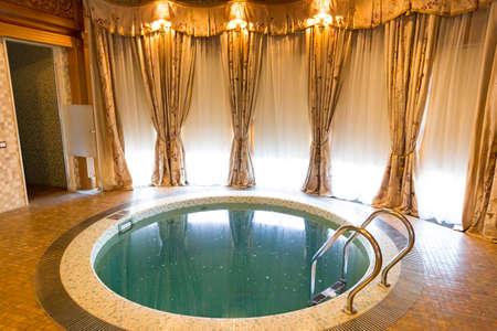 sumptuousness: Novi Petrivtsi, Ukraine - May 27, 2015 Mezhigirya residence of ex-president of Ukraine Yanukovich. Luxurious room with small swimming pool Editorial