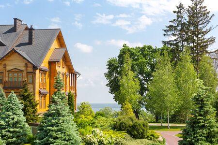 luxuriance: Novi Petrivtsi, Ukraine - May 27, 2015 Mezhigirya residence of ex-president of Ukraine Yanukovich. Side view of Khonka house exterior