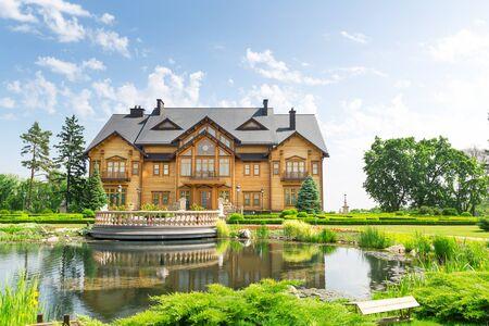 splendour: Novi Petrivtsi, Ukraine - May 27, 2015 Mezhigirya residence of ex-president of Ukraine Yanukovich. Khonka house exterior Editorial