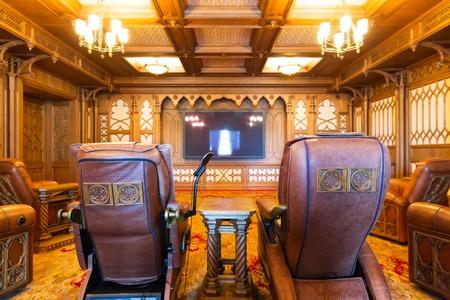 sumptuousness: Novi Petrivtsi, Ukraine - May 27, 2015 Mezhigirya residence of ex-president of Ukraine Yanukovich. Modern home theater room interior with soft comfortable chairs Editorial