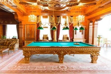 snooker room: Novi Petrivtsi, Ukraine - May 27, 2015 Mezhigirya residence of ex-president of Ukraine Yanukovich. Luxurious billiard table of Khonka house