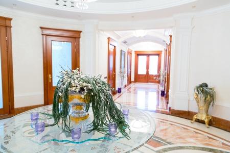 splendour: Novi Petrivtsi, Ukraine - May 27, 2015 Mezhigirya residence of ex-president of Ukraine Yanukovich. Close up of luxurious modern hall