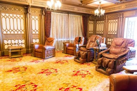 sumptuousness: Novi Petrivtsi, Ukraine - May 27, 2015 Mezhigirya residence of ex-president of Ukraine Yanukovich. Modern home theater room interior with soft comfortable leather chairs