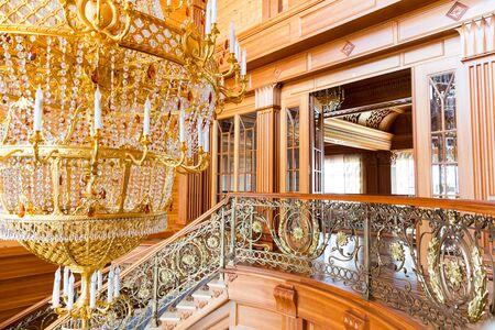 splendour: Novi Petrivtsi, Ukraine - May 27, 2015 Mezhigirya residence of ex-president of Ukraine Yanukovich. Closeup of modern gilded chandelier