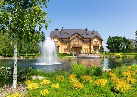 luxuriance: Novi Petrivtsi, Ukraine - May 27, 2015 Mezhigirya residence of ex-president of Ukraine Yanukovich. Khonka house exterior with fountains Editorial