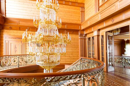 splendour: Novi Petrivtsi, Ukraine - May 27, 2015 Mezhigirya residence of ex-president of Ukraine Yanukovich. Close up of modern gilded chandelier