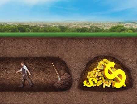 gold shovel: Businessman almost got treasure underground, but he gave up Stock Photo