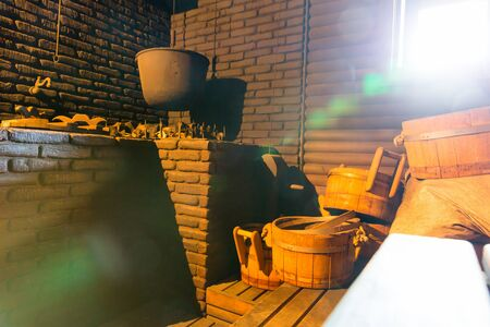 bathhouse: Cauldron for boiling water in the old bath-house room Stock Photo