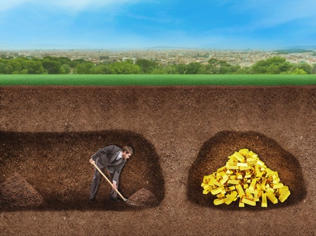 digging: Businessman digs a tunnel to treasure underground Stock Photo