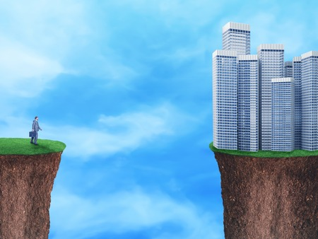 chasm: Businessman on the edge looks at the city situated on the other grass edge