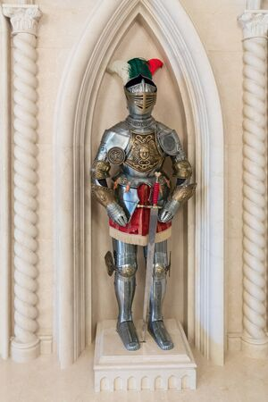 exhibit: Knight armor statue standing in the exhibit room Stock Photo