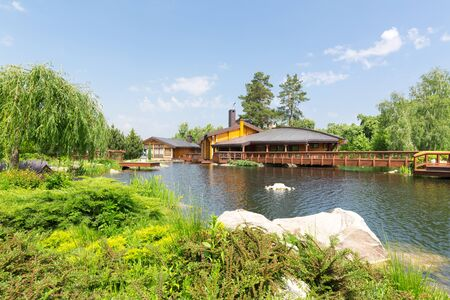 sumptuousness: Novi Petrivtsi, Ukraine - May 27, 2015 Mezhigirya residence of ex-president of Ukraine Yanukovich. Beautiful view of spa complex