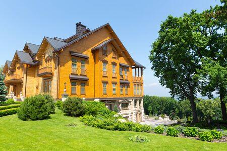 splendour: Novi Petrivtsi, Ukraine - May 27, 2015 Mezhigirya residence of ex-president of Ukraine Yanukovich. Khonka house exterior with park