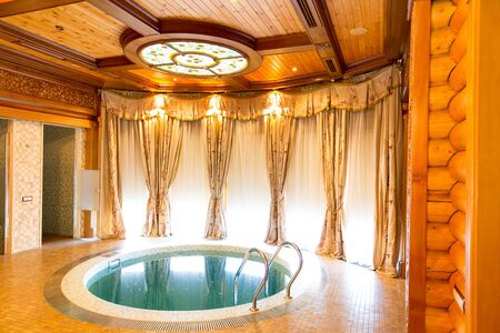 sumptuousness: Novi Petrivtsi, Ukraine - May 27, 2015 Mezhigirya residence of ex-president of Ukraine Yanukovich. Luxurious room with indoor swimming pool