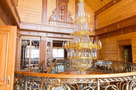 splendour: Novi Petrivtsi, Ukraine - May 27, 2015 Mezhigirya residence of ex-president of Ukraine Yanukovich. Interior of the main house with big chandelier Editorial