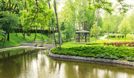 summerhouse: River in the green spring park and a summer-house