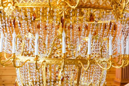 luxuriance: Close up of modern gilded chandelier
