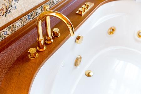 splendour: Novi Petrivtsi, Ukraine - May 27, 2015 Mezhigirya residence of ex-president of Ukraine Yanukovich. Closeup of luxurious bathroom