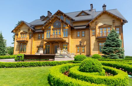 splendour: Novi Petrivtsi, Ukraine - May 27, 2015 Mezhigirya residence of ex-president of Ukraine Yanukovich. View of Khonka house exterior with flower-beds