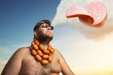 wurst: Man with sausages round his neck dreaming about a piece of wurst