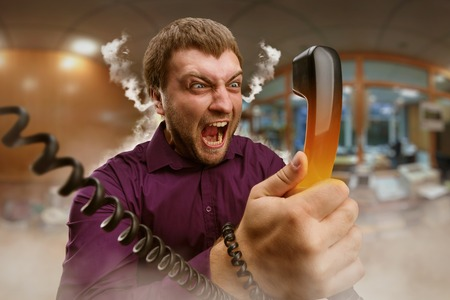 shouting: Angry bearded man screaming into the phone