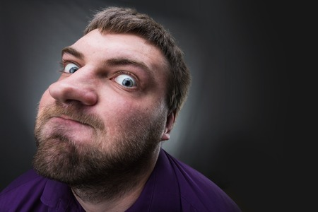 business skeptical: Frustrated man over grey background Stock Photo
