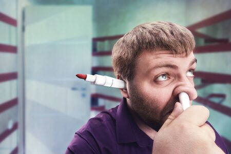 loony: Strange bearded man with highlighter in the ear and in the nose
