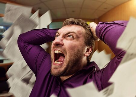 screaming: Mad businessman screaming in the office Stock Photo