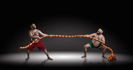 hunger: Two men fighting for sausages over black background