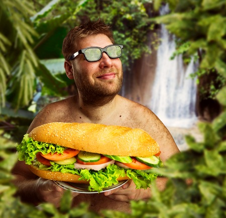 dirty man: Happy man in glasses with a big sandwich against nature