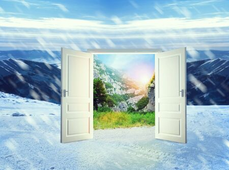 out of doors: White door to good weather in winter mountains Stock Photo