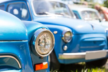 old fashioned car: Line of blue retro cars close up