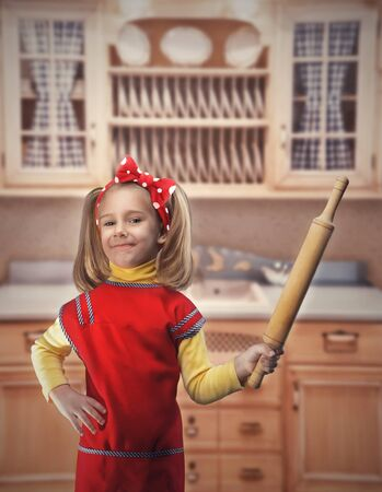 rollingpin: Happy blond girl with rolling-pin in the kitchen