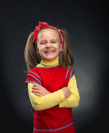 portrait studio: Happy little girl is smiling over grey background Stock Photo